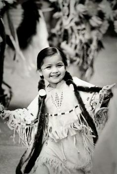 I love this photo of this precious little Native American girl. Full of life! May this Native American child always be this blissfully happy!