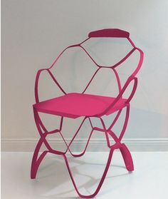 Looks like a flat piece of cut paper has been pulled up from the ground to create this chair.