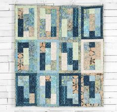 """Who knew simple strips, rectangles and squares could create a quilt top that will make you want to stop and stare? Bring this Slide Rule Quilt Kit to life by using the included pattern and Tonga Treats fat quarters. You may not remember how to use a slide rule, but you definitely won't forget how fun it was to piece this gorgeous 48 ½"""" by 54 ½"""" quilt top."""