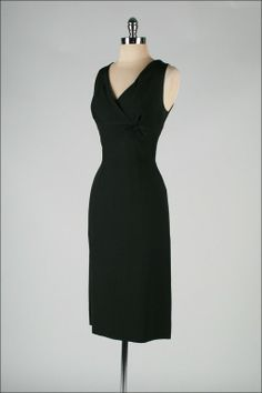 Vintage 1950's Pierre Balmain Black Silk Cocktail Dress | From a collection of rare vintage evening dresses at http://www.1stdibs.com/fashion/clothing/evening-dresses/