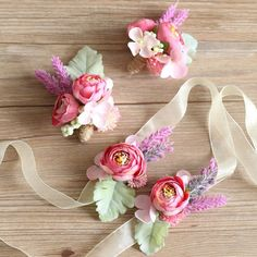 - Features purple peony buds, lavender, succulents and flat dusty miller - Available as a lapel boutonniere or a wrist corsage - Boutonniere includes twine string wrap - Slide pin on the back of bouto