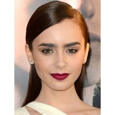 How to do Lily Collins Berry Lips the grown up way.  Deep berry shades were all over the catwalks for AW16, and now that autumn is officially here we're swapping out the paler summer colours for dark, broody lips.   Whether you're wearing it to a cocktail party, out for dinner or even during a lazy Saturday; you're sure to find a colour that suits you.  TIP: Put lashings of clear gloss over the top of your deep berry shade to make the look less goth and more luxe.