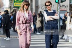 Guests wearing pink striped overall, and denim overall outside Dolce