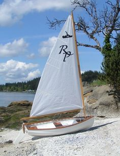 The Minto Sailing Dinghy is a sailing dinghy first produced commercially in the early 1960 and still in production. The Minto Sailing Dinghy began its life as a skiff for a 24 foot sloop built by Hugh Rodd at Canoe Cove on Vancouver Island. Sailing Dinghy, Sailing Ships, Catamaran, Dinghy Boat, Sailing Boat, Plywood Boat, Wood Boats, Sailing Girl, Sailing Lessons