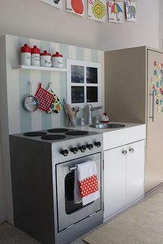"cute diy play kitchen. for the kids' play room.. I like the ""pantry/fridge"" to hold all the stuff.."
