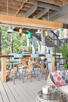 Located Underneath The Home On Stilts, The Lower Deck Offers An Inviting  Space For Entertaining