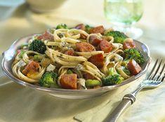 Hot sauce, gorgonzola, and pesto add a unique and delicious heat to this Kielbasa and Broccoli Linguine.