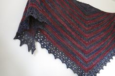 Thieves' Road Shawl knitting pattern by Littletheorem Knits on Ravelry. A shallow triangular shawl with zigzag stripes and a pretty lace edging. The yarn is Malabrigo Rastita in colourways No me Olvides and Jupiter.