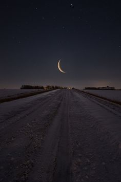 """""""Frozen Road to Nowhere"""" Waning Crescent Moon rises over a snow covered gravel road in eastern South Dakota. www.HomeGroenPhotography.com"""