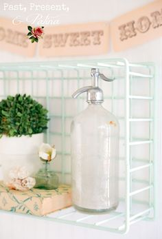 Vintage metal basket transformed into pretty wall shelf with chalk paint!