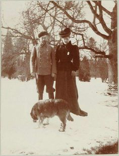 """Tsar Nicholas ll of Russia and Empress Alexandra Feodorovna of Russia photographed walking one of Nicky's favourite dogs,Voran,in the Alexander Palace Park,Tsarskoe Selo in 1908. """"AL"""""""