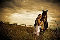 I love the lighting in this picture! Great idea for a Sr. photo shoot with horses.