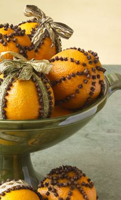 Christmas Decorating DIY Projects: Fill your home with a delicious tropical scent this holiday by embellishing navel oranges with cloves and ribbon. These festive orange pomanders can be used as a centerpiece in a decorative bowl, on the mantel or as a lovely gift.
