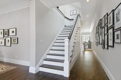 Balboa Mist (benjamin moore). Another beautiful soft gray color.  Love the staircase