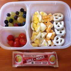 Organic hard-boiled egg, cheese cubes, yogurt-covered pretzels, organic grape tomatoes, grapes, blueberries, and a fruit bar