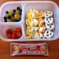 Organic hard-boiled egg, cheese cubes, yogurt-covered pretzels, organic grape tomatoes, grapes, blueberries, and a fruit bar