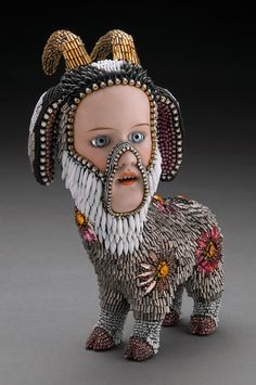 """Betsy Youngquist """"Harry"""" 2011 8x7x4 in. Antique porcelain doll parts, glass beads, vintage glass stones, glass doll eyes, grout."""