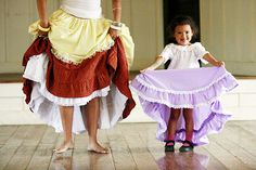 CINDY ELLEN RUSSELL / CRUSSELL@STARBULLETIN.COM Aaliyah Huertas, 3, followed her mother's lead, above, while performing a Puerto Rican folkloric dance during the Hawaii's Plantation Village Celebration of Rice event held in Waipahu on Saturday.