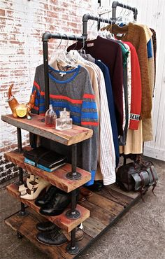 Clothes caddy from recycled wood and metal pipes. This would be great for a closet or retail store front.  that iron pipe can be pricey though.