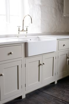 The Real Shaker Kitchen by deVOL, painted in 'Mushroom'. Love this colour, like the shape of the tap.
