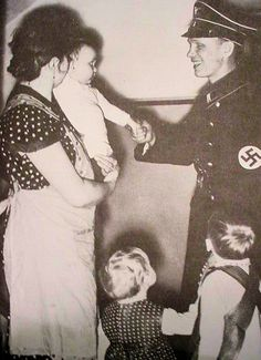 """A Lebensborn visitor. Lebensborn (Fount of Life) was an SS-borne, state-supported, registered association in Nazi Germany with the intention of raising the birth rate of """"Aryan"""" children from extramarital relations of """"racially pure and healthy"""" parents on the basis of Nazi racial hygiene and health ideology."""