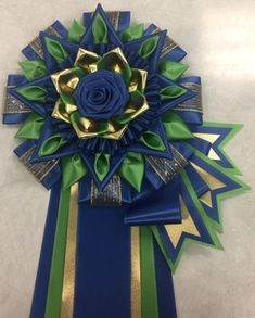 View our collection of ribbons and rosettes available in accents including floral, patterned, glittery golds, silvers and more. Ribbon Rosettes, Ribbon Art, Ribbons, Homecoming Corsage, Centaur, Sash, Photo Galleries, Corsages, Gallery