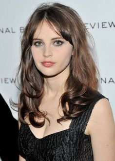 Felicity Jones Long Hairstyles with Side Swept Bangs