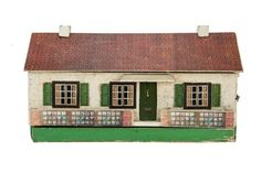 A Tri-ang Wooden Dolls' House Bungalow No 5 Q, rough-cast façade, tinplate windows, printed green card shutters, green front door with letter box, printed paper tiled roof, front opening at one end to reveal three rooms, fireplaces, original papers and one room electrically-lit, lift off roof with attic space and roundel on back --25in. (63.5cm.) wide (F-G, printed garden replaced)