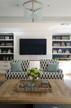 white book shelves with navy wall behind shelves