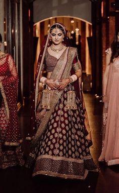 Looking for Pretty gold and maroon bridal lehenga for wedding? Browse of latest bridal photos, lehenga & jewelry designs, decor ideas, etc. Indian Bridal Outfits, Indian Bridal Fashion, Indian Bridal Wear, Indian Designer Outfits, Indian Wedding Lehenga, Indian Lehenga, Dulhan Dress, Sabyasachi Lehengas, Bridal Lehenga Collection