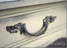 Hmmm..... I like the idea of a bit of zinc/banged up silver peaking out of the black on my bedroom furniture......