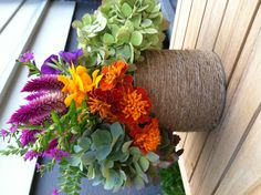 Twine-wrapped can as a vase.