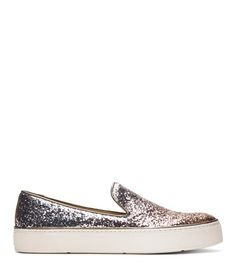 Slip-on sneakers go glam this season by way of a unique multi-colored glitter finish. Cut lower on the sides for a more feminine silhouette, this update on the sport-luxe staple is equally fabulous as it is comfortable.