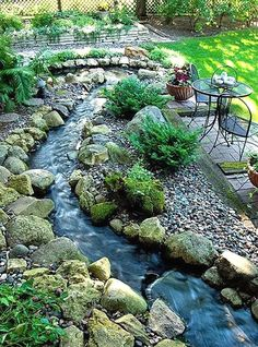 Beautiful Backyards: Inspiration for Garden Lovers beautiful backyard gardens Backyard Landscaping Ideas Gardening - its-a-green-life. Good idea for drainage area. Small Backyard Landscaping, Ponds Backyard, Landscaping Ideas, Backyard Ideas, Backyard Stream, Backyard Designs, Landscaping Software, Garden Stream, Sloped Backyard