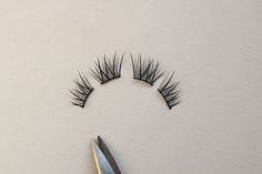 mastering fake eyelashes: cut into segments, and put UNDERNEATH lashes