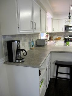 Scott & Allie break down the cost of their kitchen redesign and renovation featuring Formica® 180fx® laminate Soapstone Sequoia.