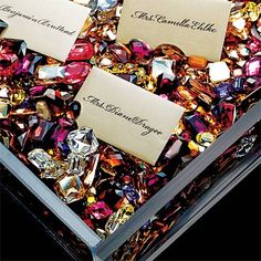 Place cards in a bed of jewels make a great wedding decoration and match your theme #jeweltone #wedding
