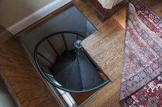 A trap door reveals a spiral staircase that leads to the wine processing rooms downstairs.
