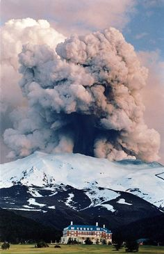 An eruption cloud from NZ Mt. Ruapehu dwarfs 'The Chateaux' lodge, in the foreground.