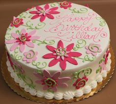 Shades of pink rolled chocolate flat daisies with green swirls and stems.
