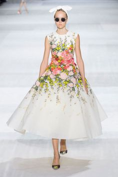 Giambattista Valli channels an era of elegant, vintage glamour and nonchalant cool for couture http://uk.bazaar.com/1pWBnEd