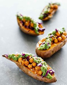 Baked sweet potatoes with chickpeas and broccoli pesto.