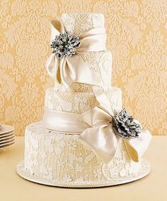 do not like the lace on the cake but the silk ribbon and the silver flowers would be gorgeous!!!