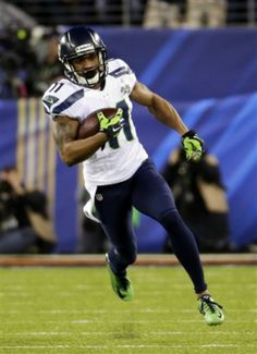 seahawks percy harvin | Photo: Seattle Seahawks' Percy Harvin (11) carries the ball during the ... Percy Harvin, University Of Florida, Seattle Seahawks, American Football, Football Helmets, Champion, Guys, Football, Boys