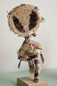 The Danza de la Pluma always concludes the Guelaguetza dance programs in Oaxaca.  This figure of a pluma dancer is made from totomoxtle or cornhusks.  Seen at the Museo Estatal de Arte Popular Oaxaqueno in San Bartolo Coyotepec, Oaxaca