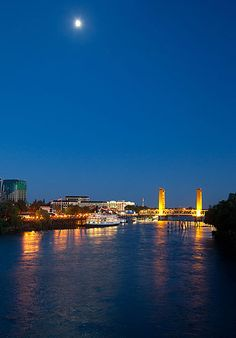 The Sacramento Skyline, including the Tower Bridge and Delta King, from the River at night..