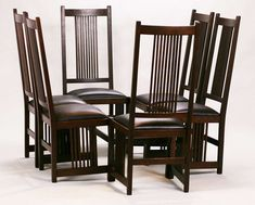 Set of 6 Gustav Stickley tall, spindled side chairs.  Unsigned.  Refinished.  This classic version rarely ever comes to market.