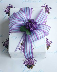 purple and blue striped bow. Cute touch to wedding favors