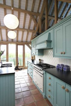 Simple shake-style kitchen in oak frame barn house in Cornwall