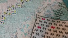 Baby quilt gray with elephants.